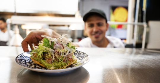 A Mexican chef working in an authentic Mexican restaurant kitchen