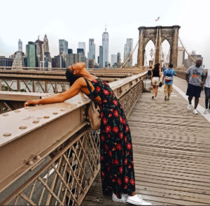 Lindiwe on a bridge in New York City, feeling the relief of not needing to apologize.