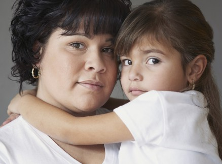 Mother and daughter with dark hair and brown eyes --- Image by © Phillip Graybill/Corbis
