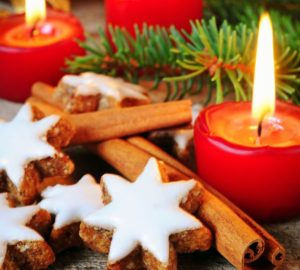 Traditional cinnamon stars biscuits over wooden texture