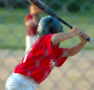 Boy up to bat in baseball game