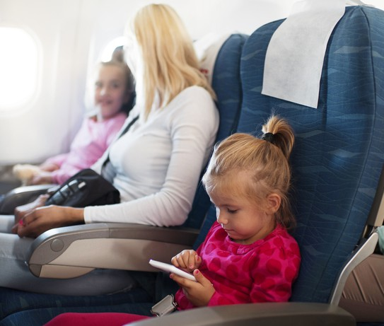 Little Girl Using Smart Phone In Airplane
