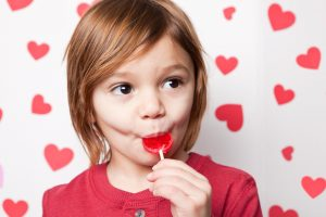 Young Boy Eating Valentine Lollipop
