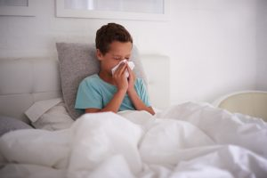 Can a Child's Allergy to Dust Cause Sneezing Fits in the