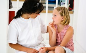 School nurse with student