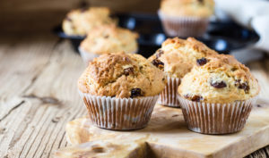 Breakfast cornmeal muffins with raisins, traditional american home baking.