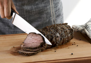 Pepper crusted beef tenderloin, perfect for any festive feast.