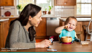 Robin Pompa feeds her son Laurence SpoonfulOne.