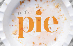 Plate with pie crust crumbs on it.