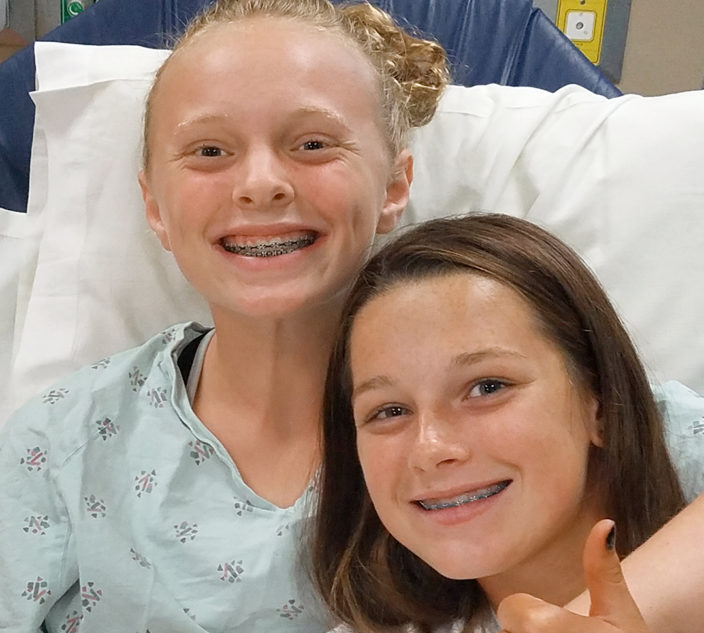 Elise and her friend Laura at the hospital.