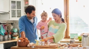 Happy family spending Easter together in the kitchen.