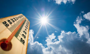 Thermometer Sun high Degres. Hot summer day. High Summer temperatures.