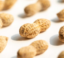 Peanuts in their shells on a white background