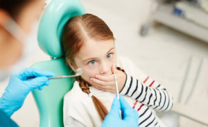 Young girl at the dentist.