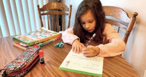 Mia Giuliani doing schoolwork at home.