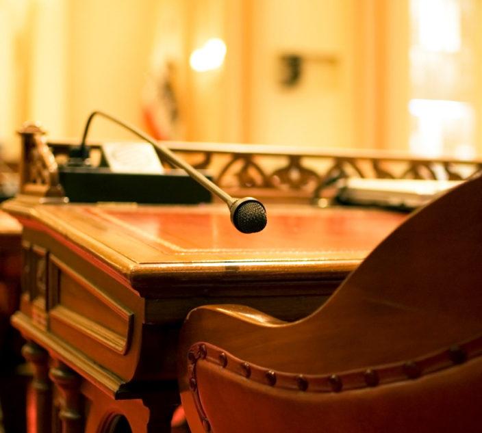 A microphone on the antique desk of a California State Senator.