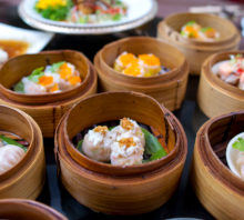 yumcha, various chinese steamed dumpling in bamboo steamer in Asian restaurant