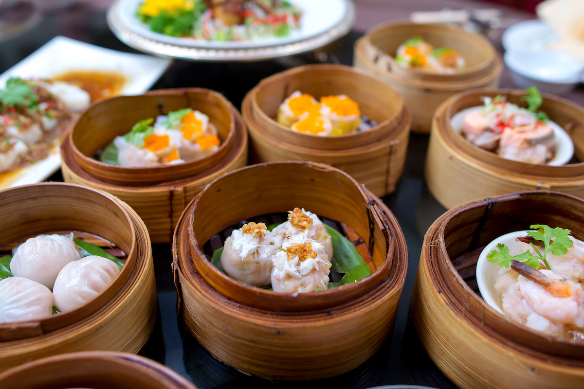 yumcha, various Asian steamed dumplings in bamboo steamer in Chinese restaurant