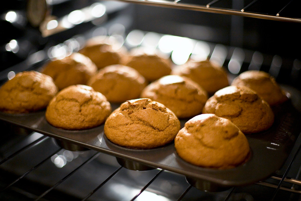 Baked pumpkin muffins just coming out of the oven