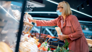 Woman shopping at grocery store.